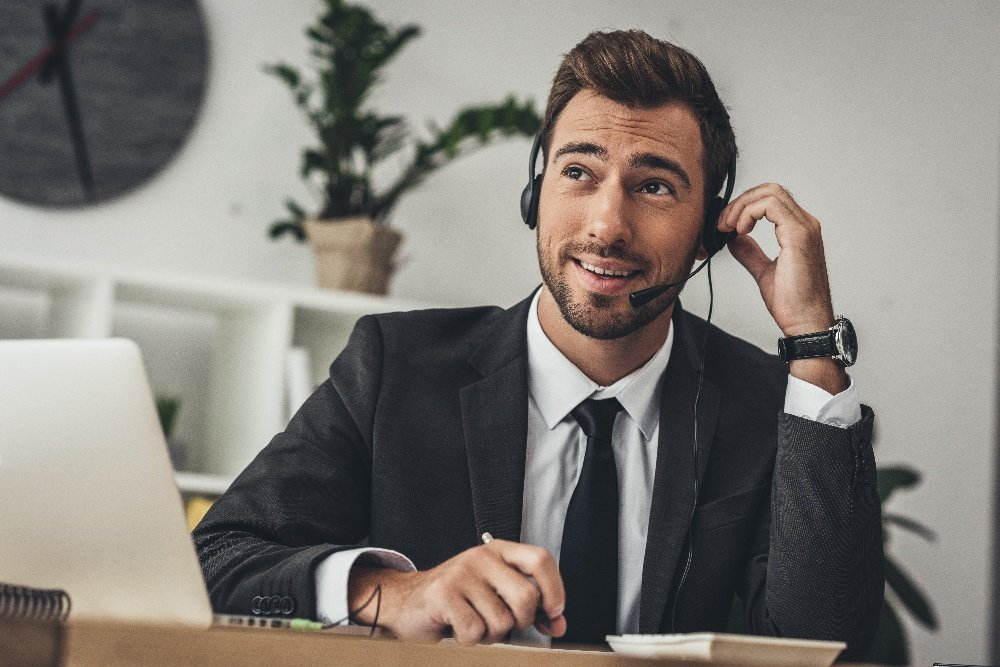 businessman-in-suit-on-headset-1