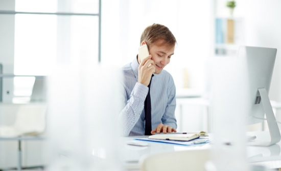 sales-person-on-phone-and-computer-1-1