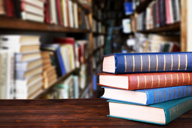 Books stacked on desk-030676-edited